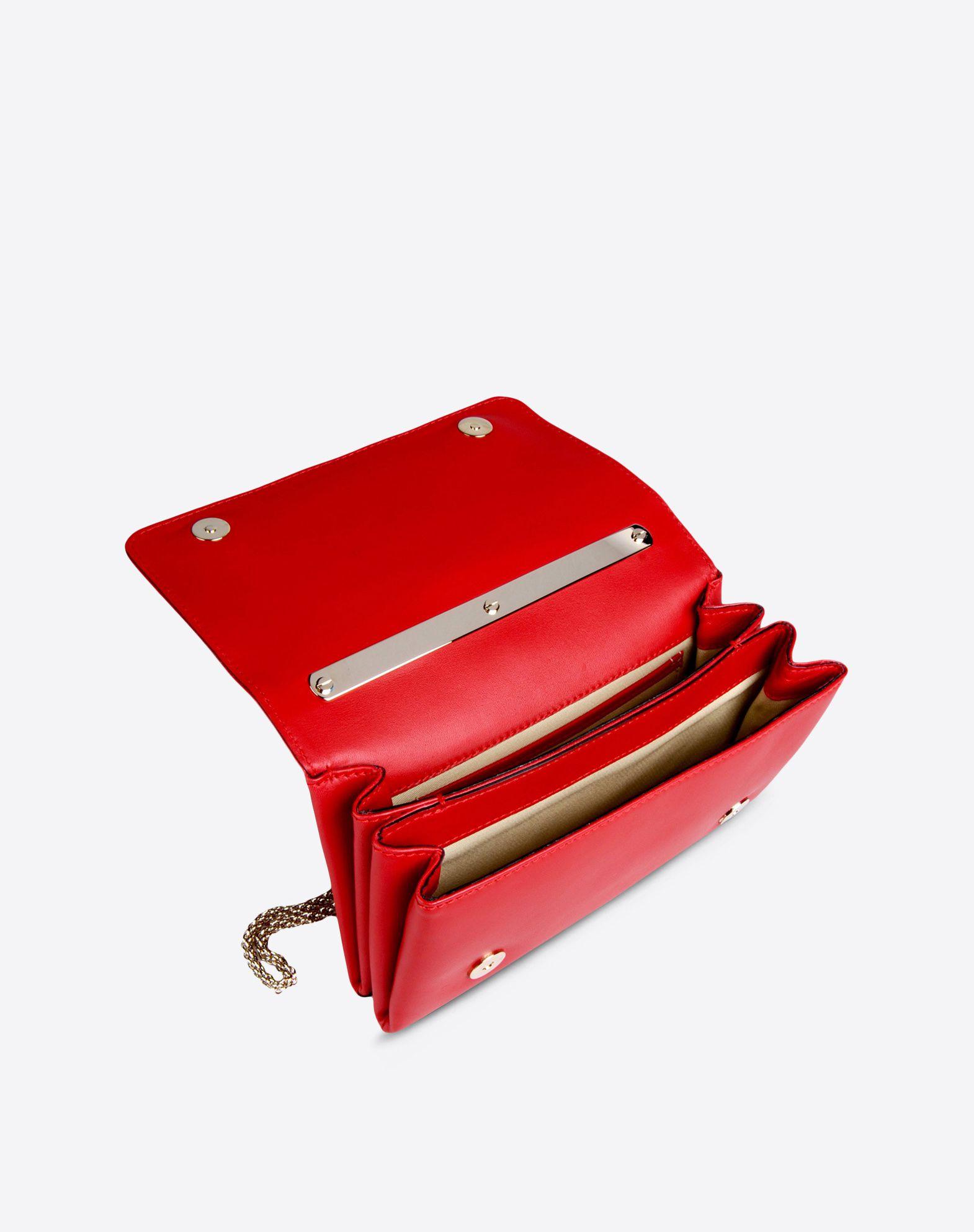 VALENTINO Solid color Magnetic closure Internal pocket Removable shoulder strap Engraved logo Metallic inserts  45204014kp