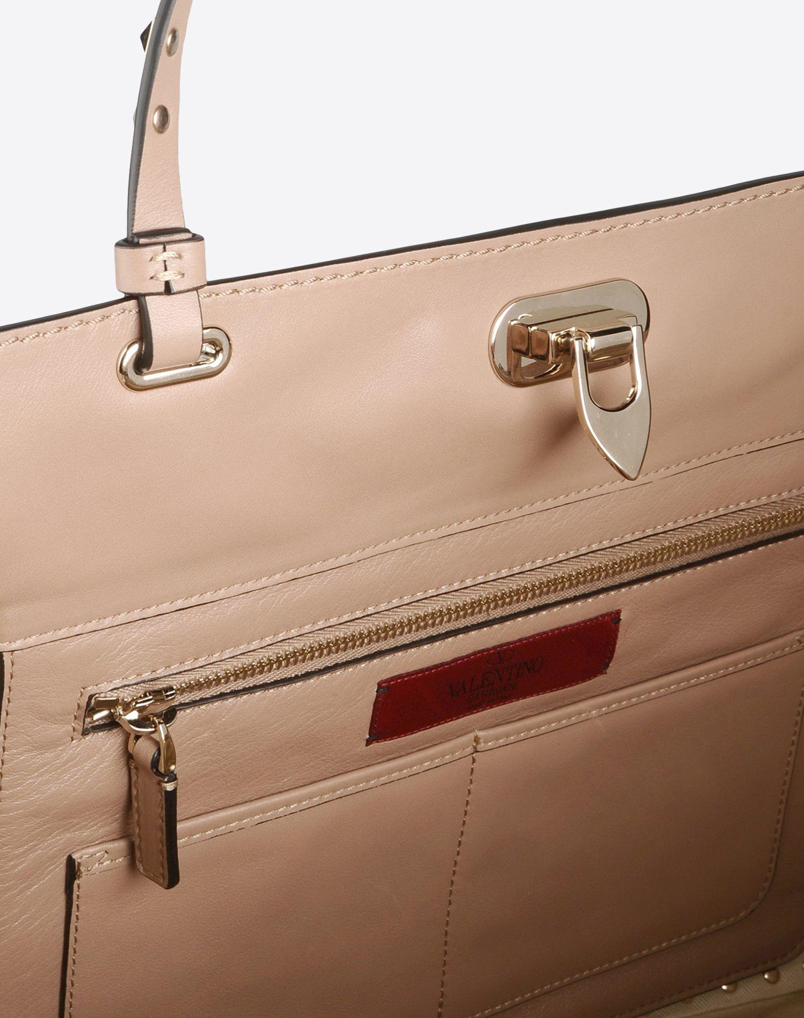 VALENTINO Solid color Framed closure Internal pockets Dual straps Metallic inserts Studs Logo detail  45204015hx