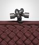 BOTTEGA VENETA STRETCH KNOT CLUTCH IN AUBERGINE INTRECCIO FAILLE MOIRE Clutch D ep