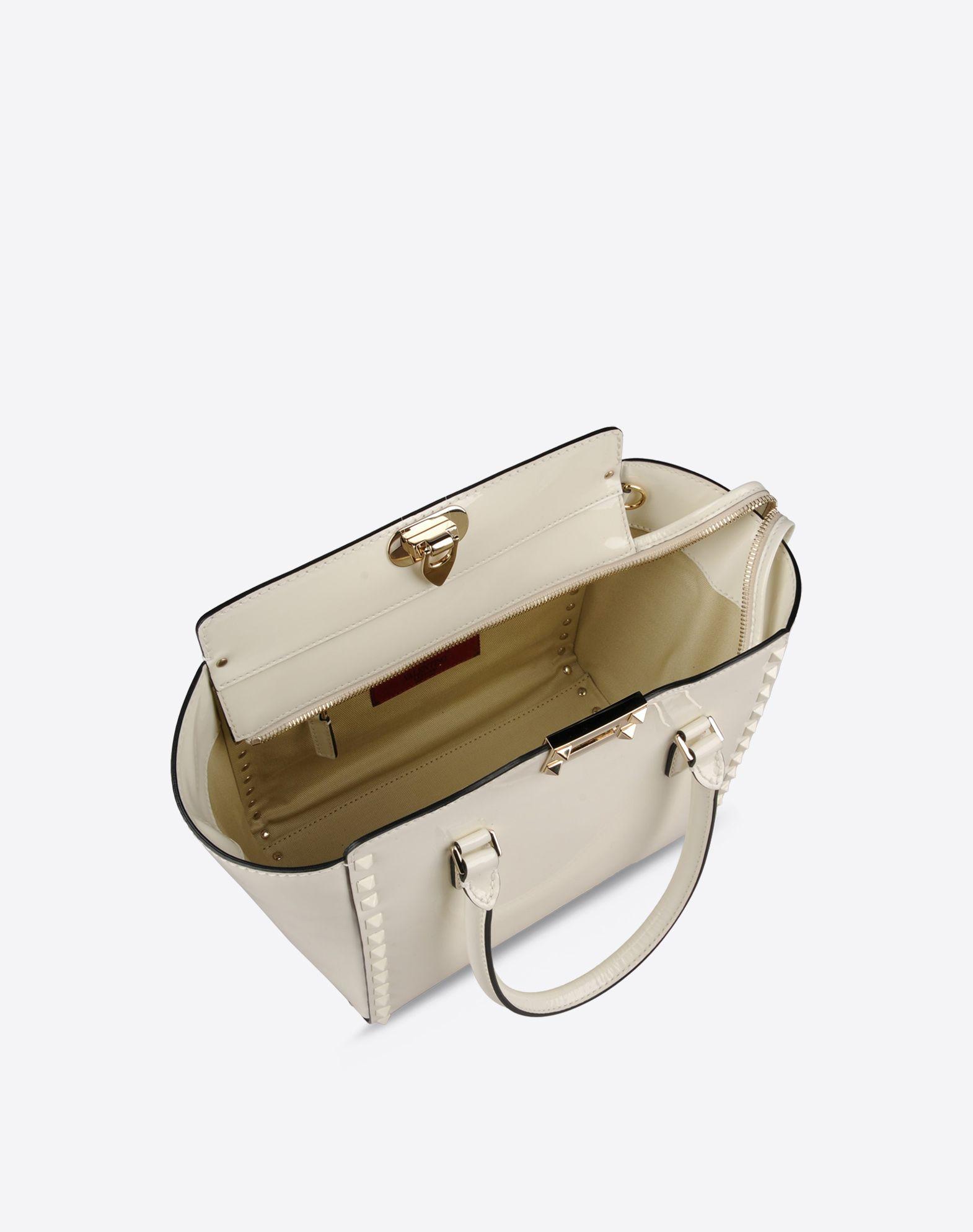 VALENTINO Double handle Logo detail Studs Varnished effect Solid color Zip closure Internal pockets Removable shoulder strap  45237060hu