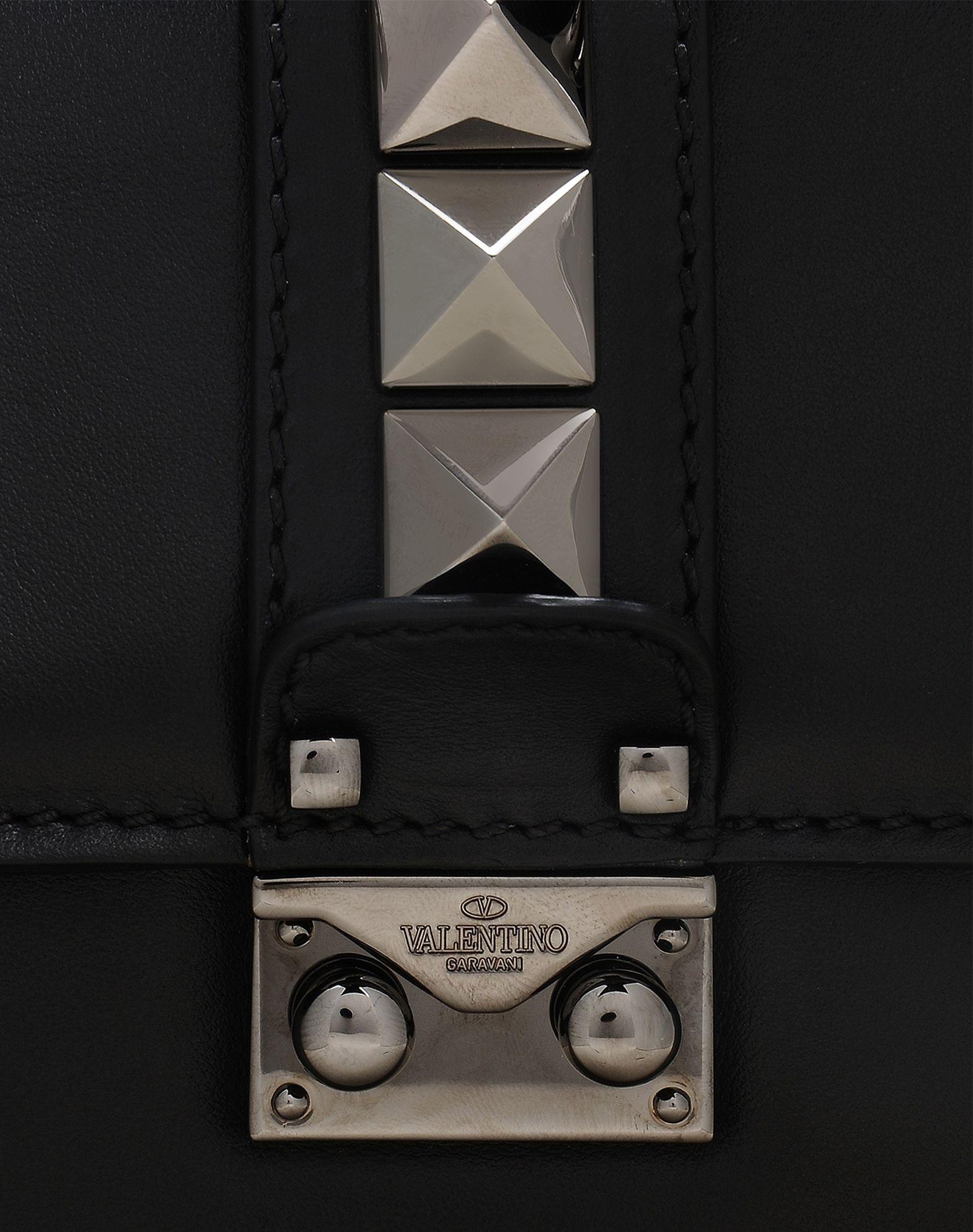 VALENTINO Solid colour Framed closure Internal pockets Removable shoulder strap Studs Logo  45304329kg