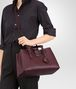BOTTEGA VENETA SMALL ROMA BAG IN BAROLO INTRECCIATO CALF Top Handle Bag D lp