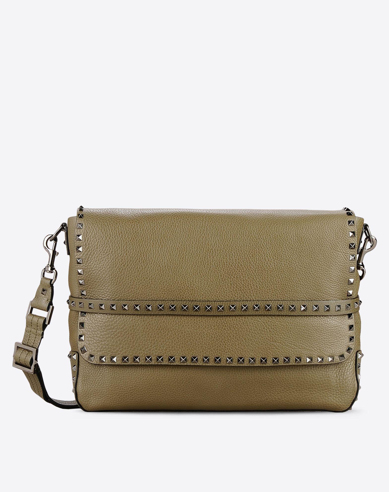 VALENTINO Textured leather Studs Logo Solid color Internal pockets Removable shoulder strap  45321745cq