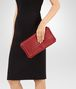 BOTTEGA VENETA CLUTCH BAG IN CHINA RED INTRECCIATO NAPPA Clutch Woman ap