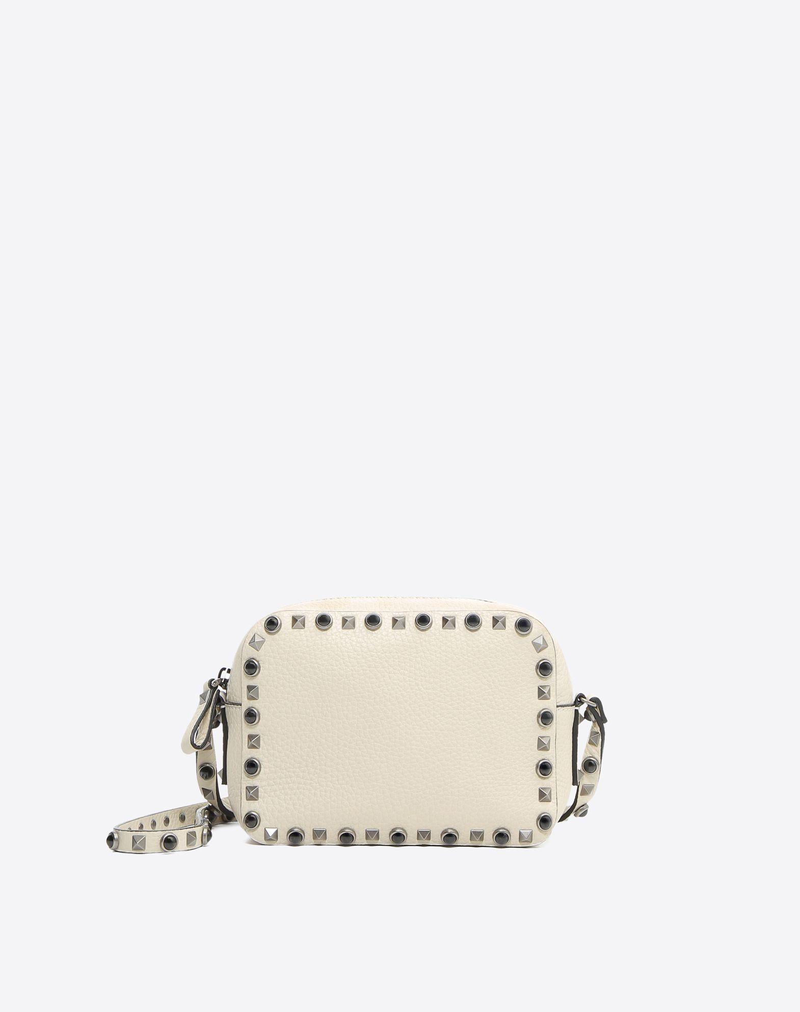 VALENTINO Textured leather Logo Studs Zip closure Internal pocket Adjustable shoulder straps  45353854hl