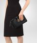 BOTTEGA VENETA MEDIUM CLUTCH BAG IN NERO INTRECCIATO NAPPA LEATHER Borsa a Tracolla Donna ap