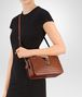 BOTTEGA VENETA MEDIUM CLUTCH BAG IN CALVADOS INTRECCIATO NAPPA Crossbody bag Woman ap