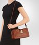 BOTTEGA VENETA MEDIUM CLUTCH BAG IN CALVADOS INTRECCIATO NAPPA Crossbody bag D lp