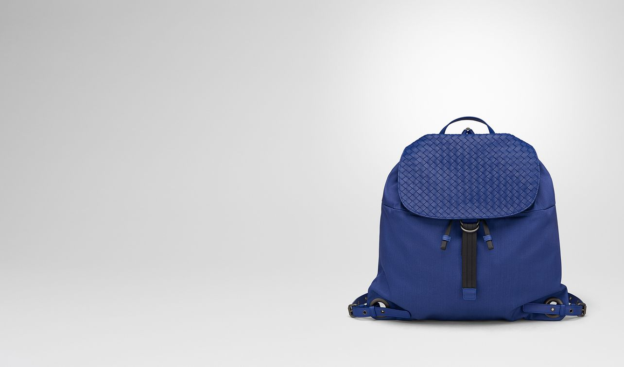 cobalt blue canvas backpack landing