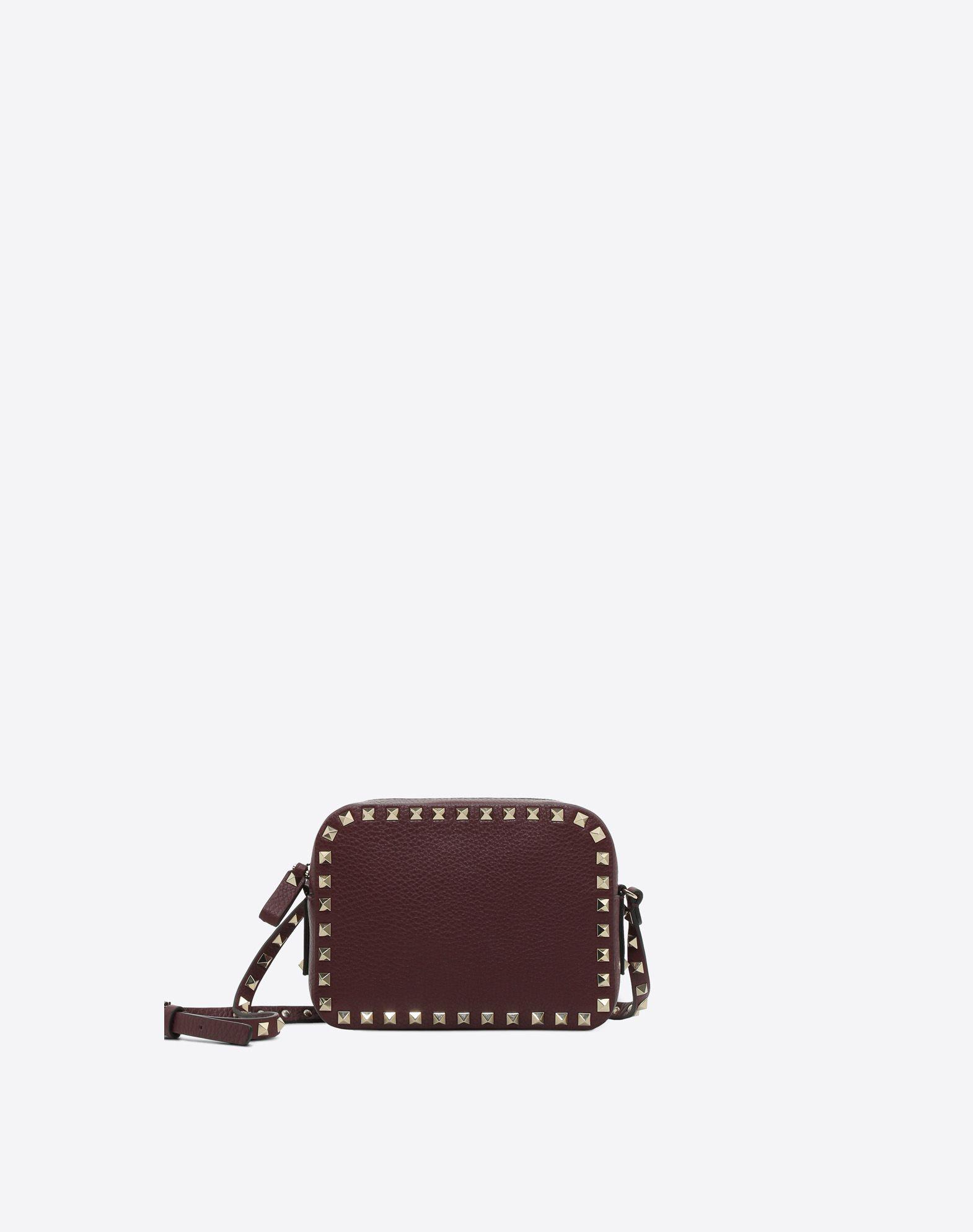 VALENTINO Studded Textured leather Logo Solid colour Zip Internal pocket Adjustable shoulder straps Messenger bags  45382335xe