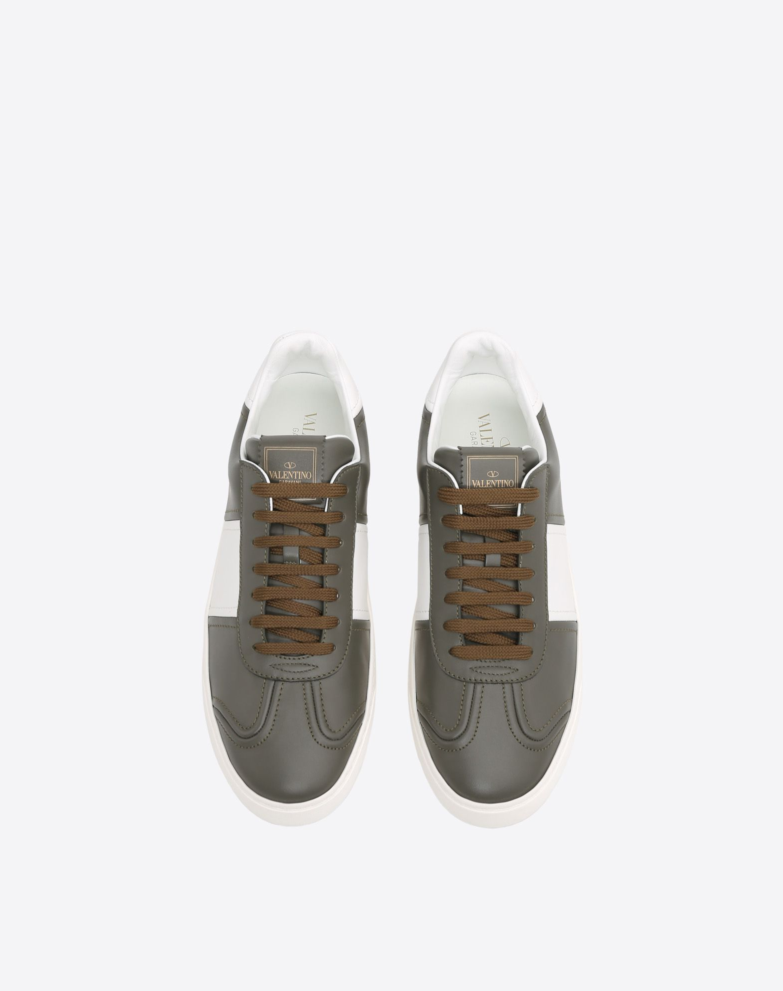 VALENTINO Two-tone Visible logo  Round toeline Leather lining Laces Rubber sole Studs  45386539vk