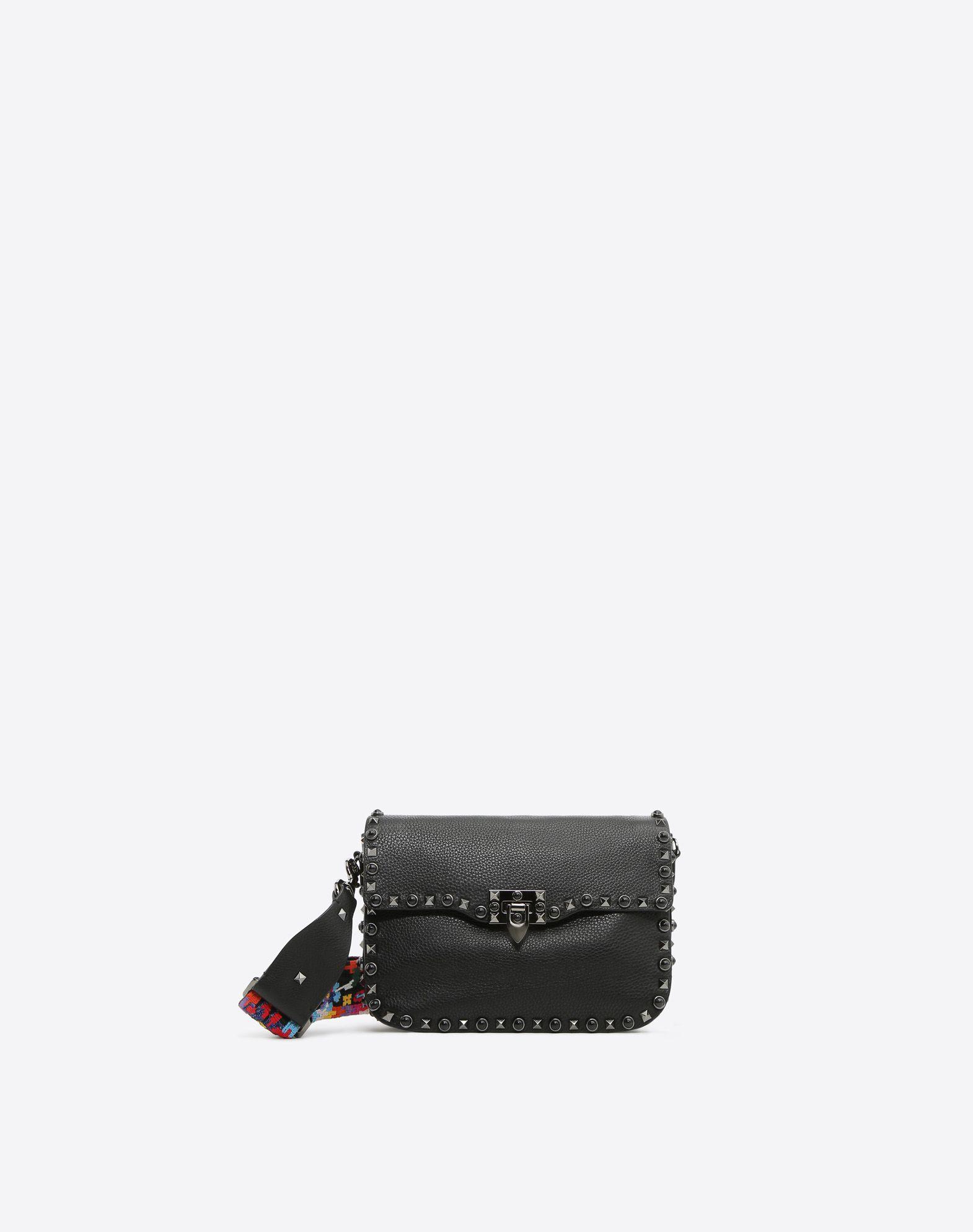 VALENTINO Studded Textured leather Logo Solid color Framed closure Internal zip pocket Removable shoulder strap  45390702an