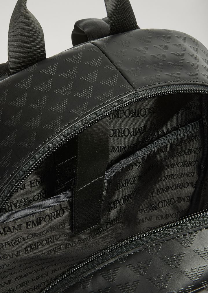 ... Backpack in bovine leather with all-over logo print. EMPORIO ARMANI d2a5fb7c9e351