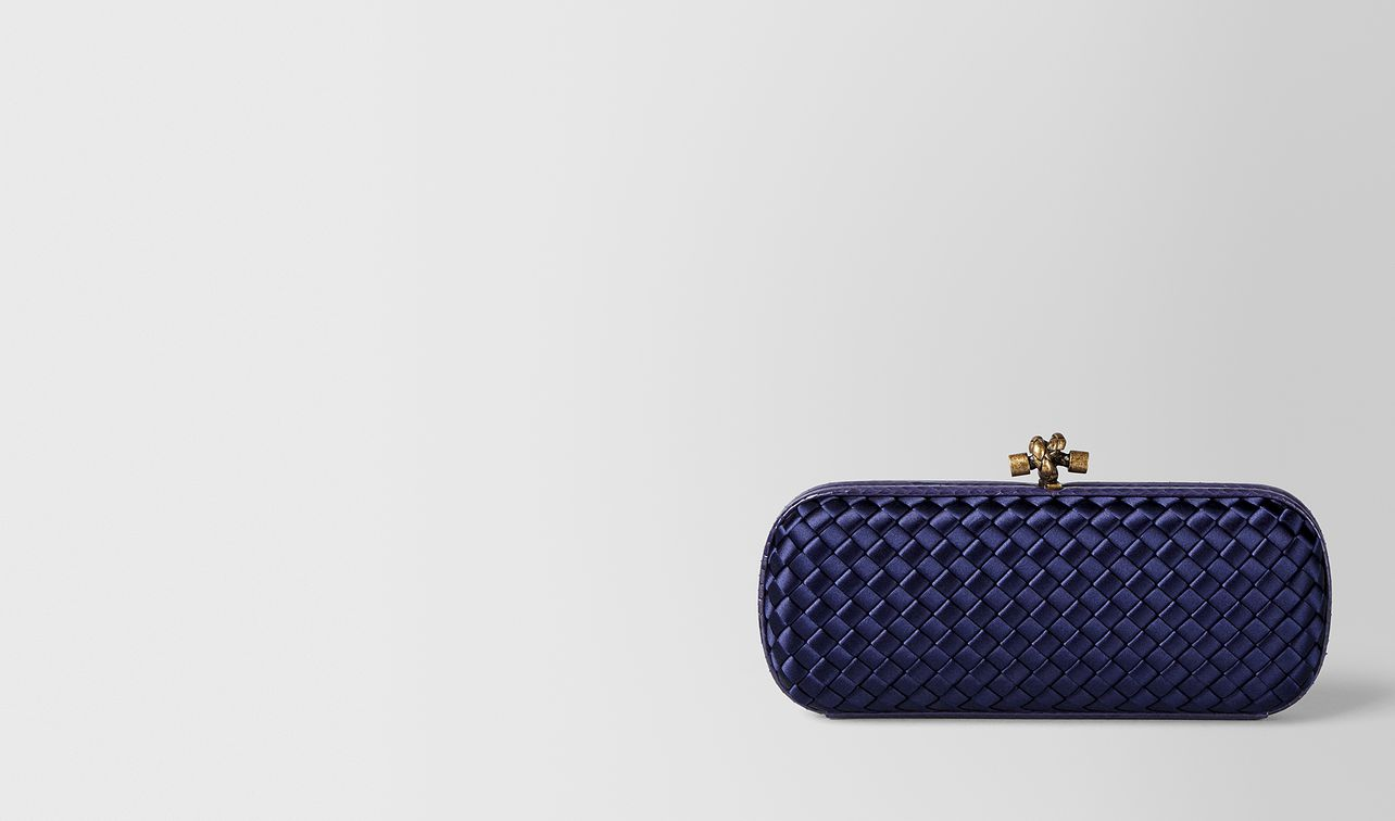 atlantic intrecciato impero stretch knot clutch landing