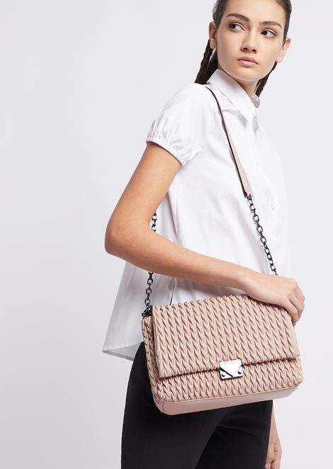 Shoulder bag with quilted section and triangular closure