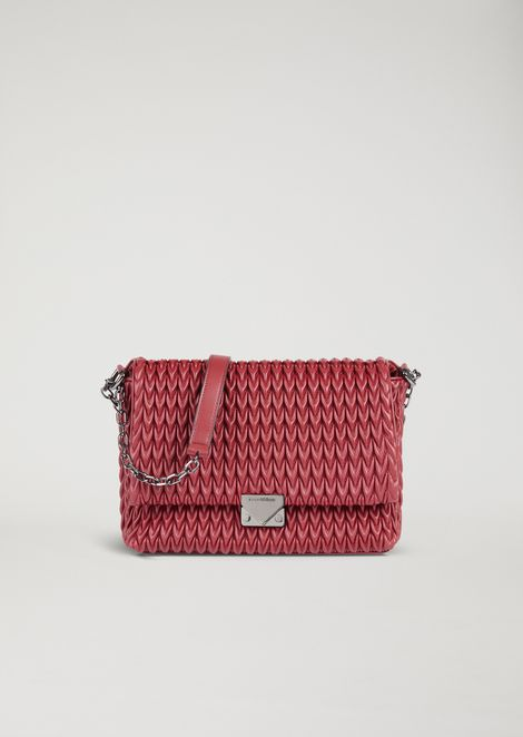 Shoulder bag with quilted design and triangular closure
