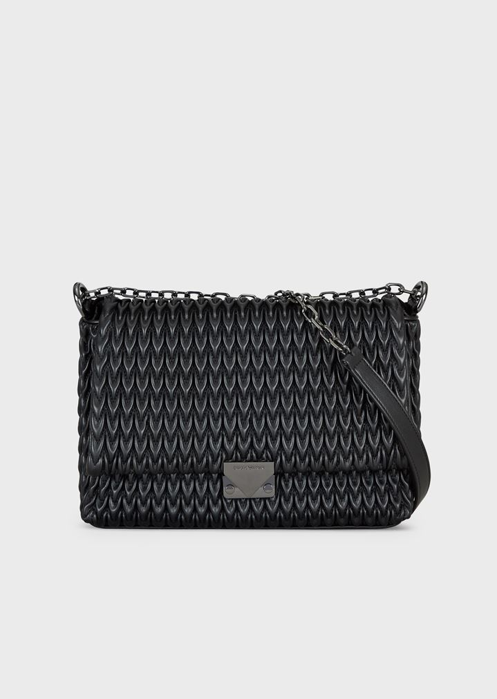 e0632c2764 Shoulder bag with quilted design and triangular closure