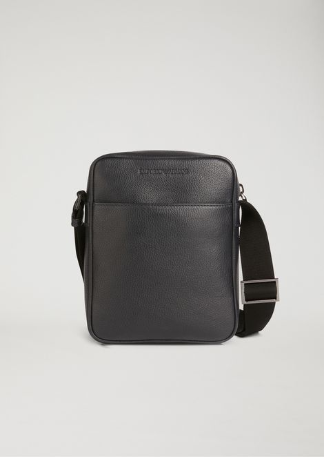 Crossbody bag in grained leather with pressed logo