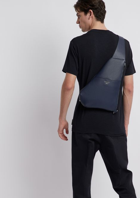 Single strap backpack in boarded leather with metal logo