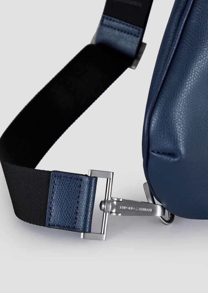 c49da47843 ... Single strap backpack in boarded leather with metal logo. EMPORIO ARMANI