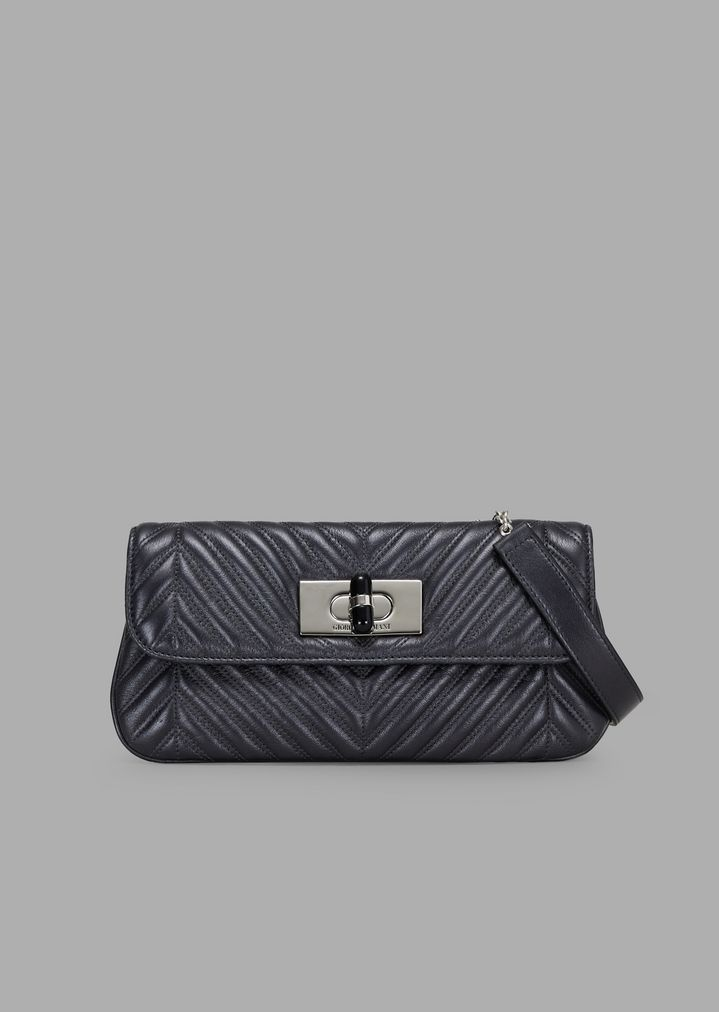 fecd752ccea2 Metallic and pleated leather clutch with a shoulder strap