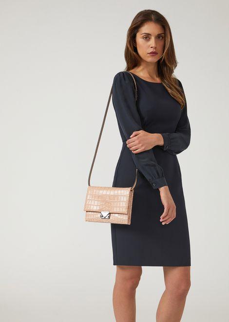 Croc print leather crossbody clutch bag with triangular fastening