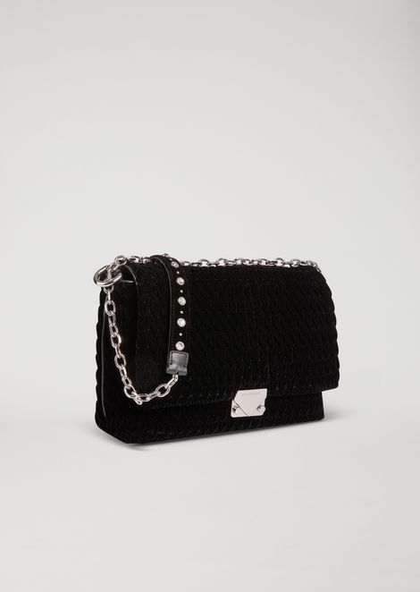Quilted velvet crossbody bag with iconic triangular closure