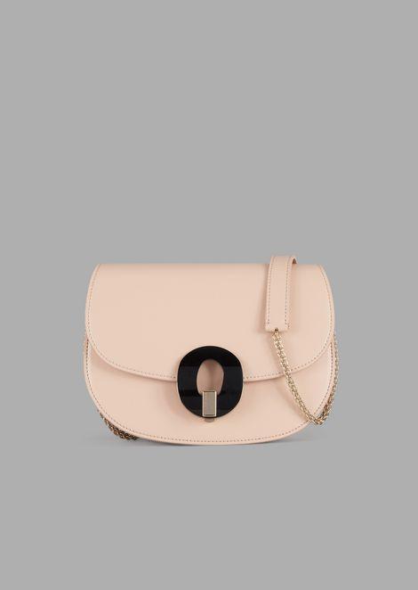 Polished leather cross-body bag with plexiglassglass clasp