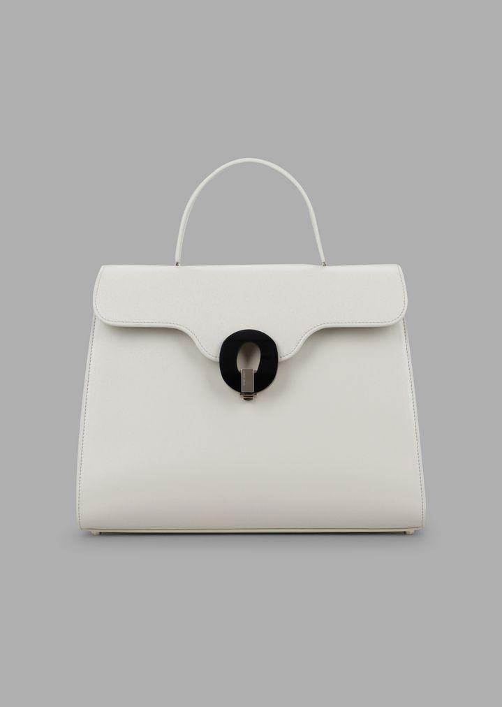 8cd28283f1 Smooth glossy leather handbag with Plexiglas closure