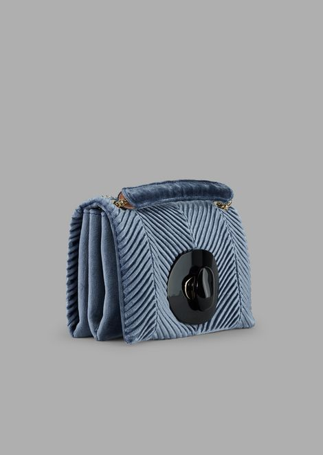 The mini shoulder bag in pleated velvet with exclusive closure