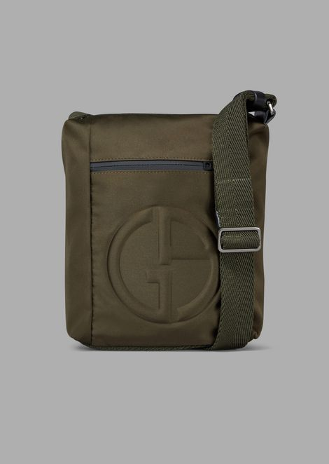 7b7a04fcf322 Cross-body bag with embossed logo and external pocket