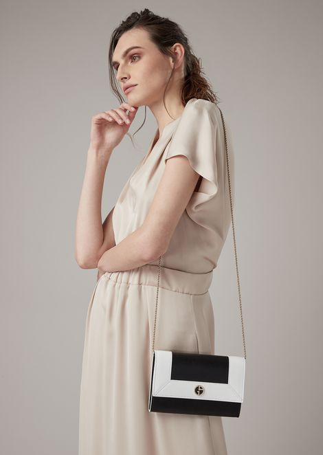 Mini cross-body bag in two-tone leather with enameled logo