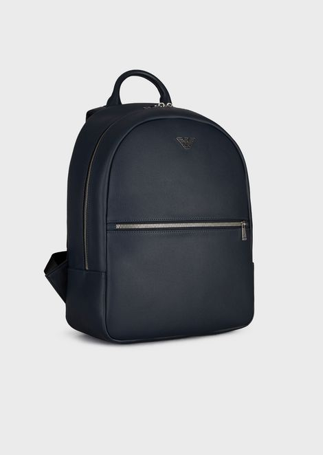 Backpack with eagle logo plate