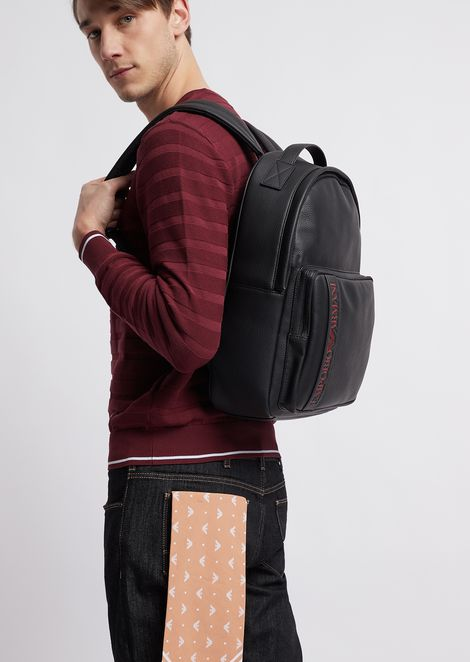 Grained leather backpack with embossed logo front pocket