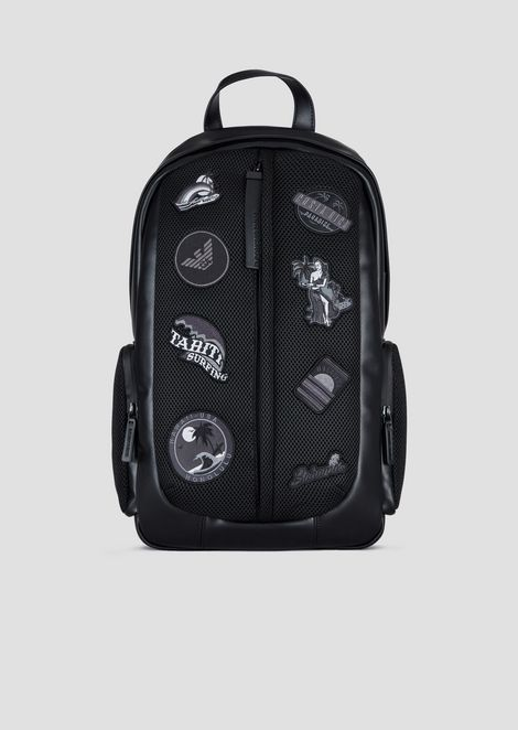 Backpack with assorted graphic patches