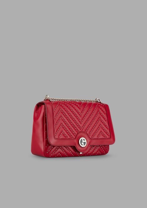 Cross-body bag in nappa leather with Chevron studs