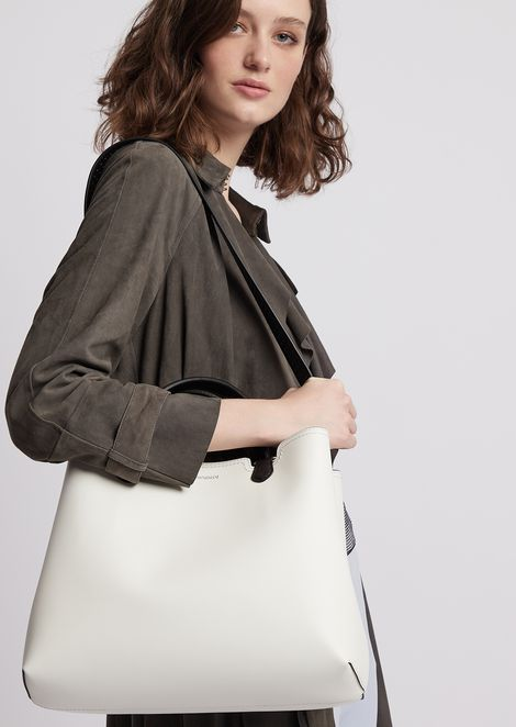 Leather shopping bag with contrasting perforated strap