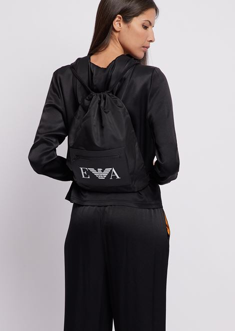 Pouch-style backpack in tech fabric with logoed pocket