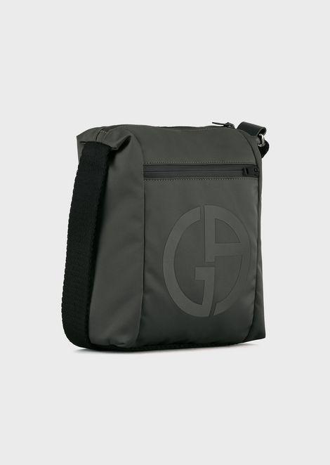 Shoulder bag with embossed logo and external pocket