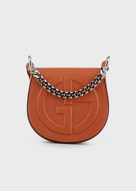 Leather round crossbody bag with raised GA logo