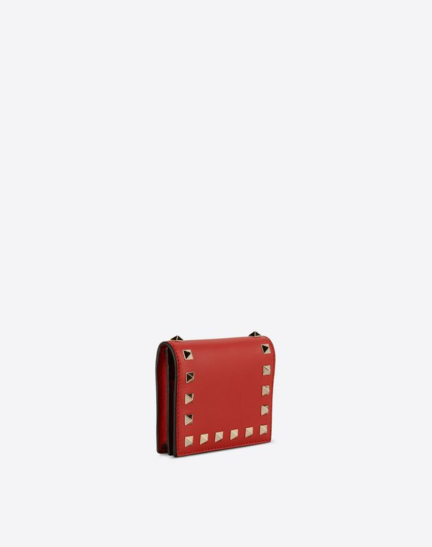 valentino case study Blue leather valentino rockstud iphone case with gold-tone pyramid studs.