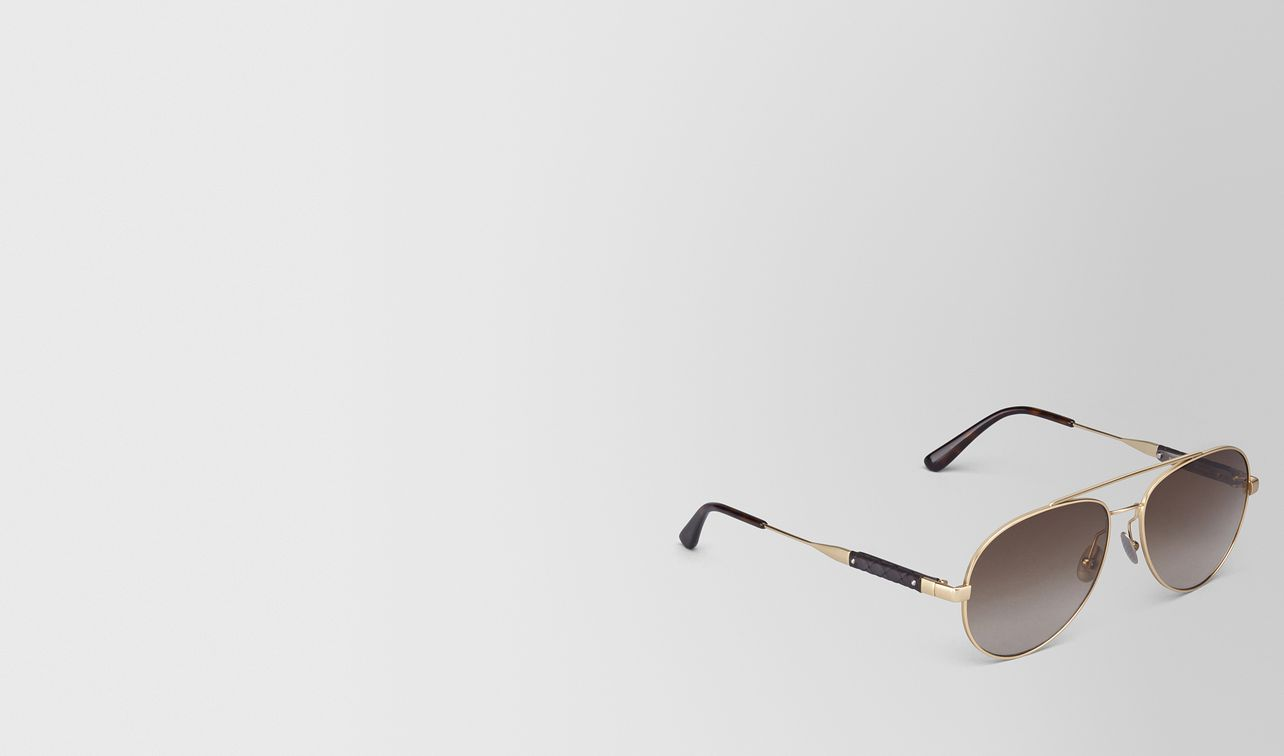 sunglasses in gold metal with brown lens landing