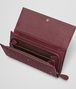 BOTTEGA VENETA CONTINENTAL WALLET IN BAROLO INTRECCIATO LAMB LEATHER WITH METAL STUDS Continental Wallet D ap