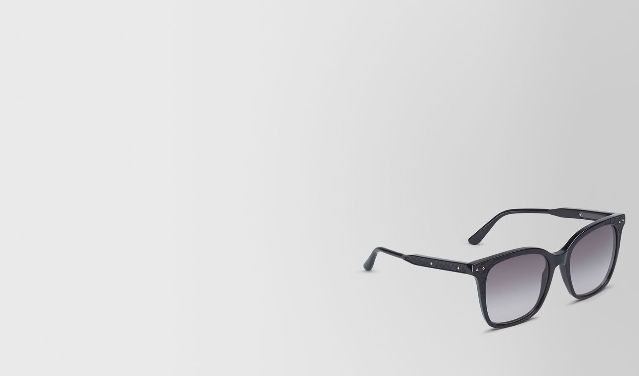 sunglasses in shiny black acetate and black leather nappa leather , gradient grey lens landing