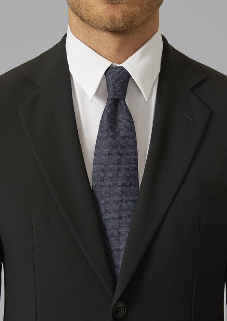 Tie with logo pattern