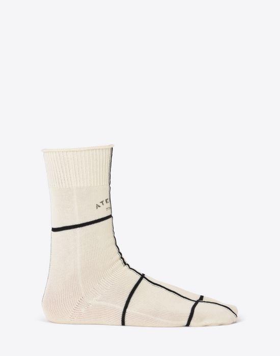 "MAISON MARGIELA Two-tone ""Atelier"" print Tabi socks Half chaps Man f"