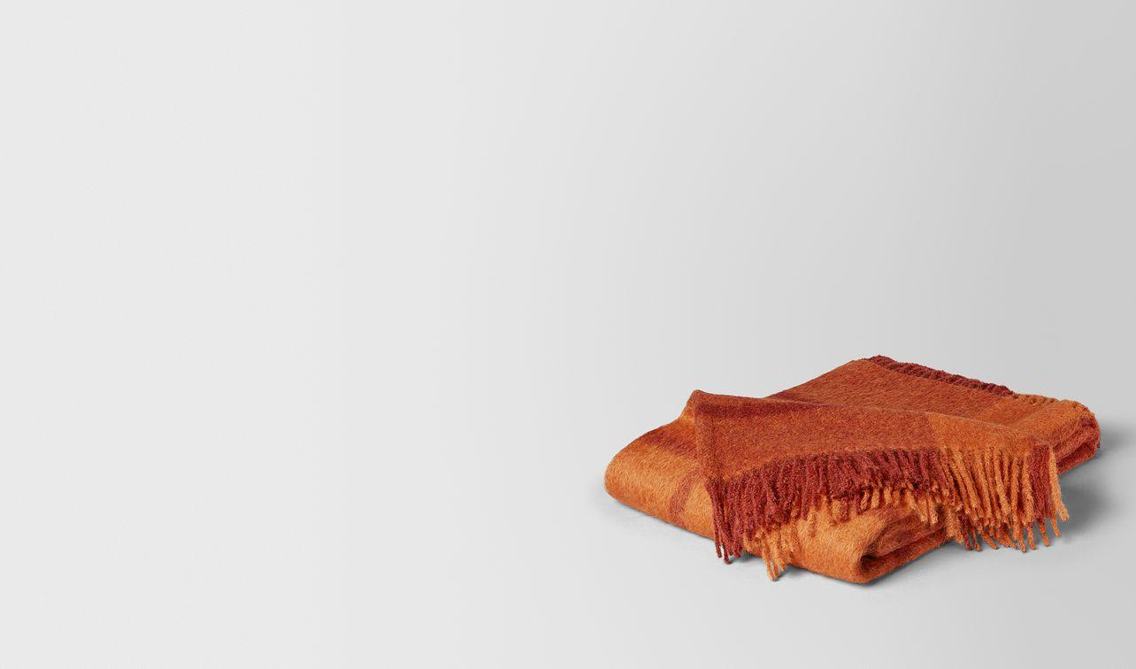 coperta kaunis in alpaca e lana tangerine orange landing