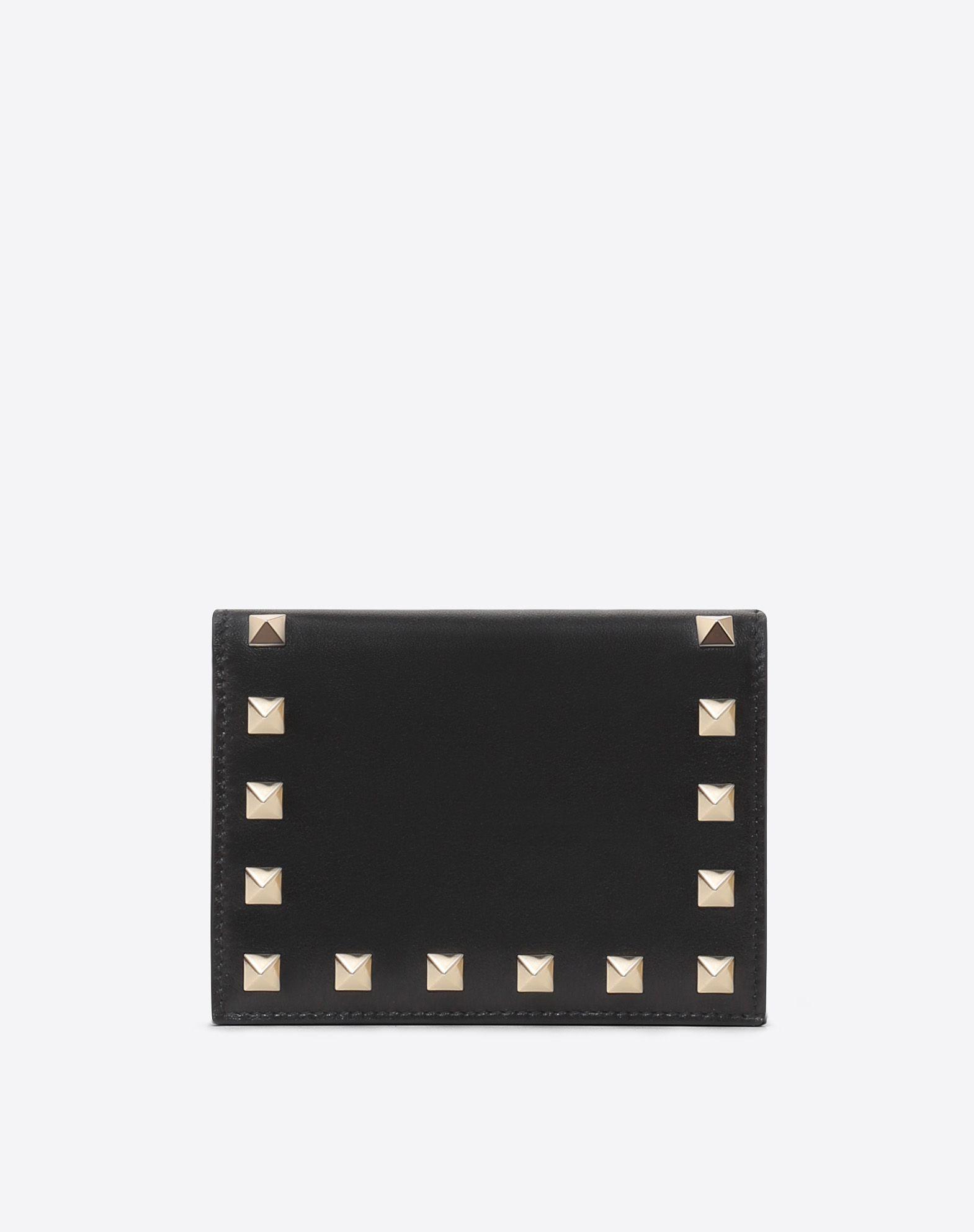 VALENTINO Polished leather Logo Solid color External side zip pocket  46579897hr