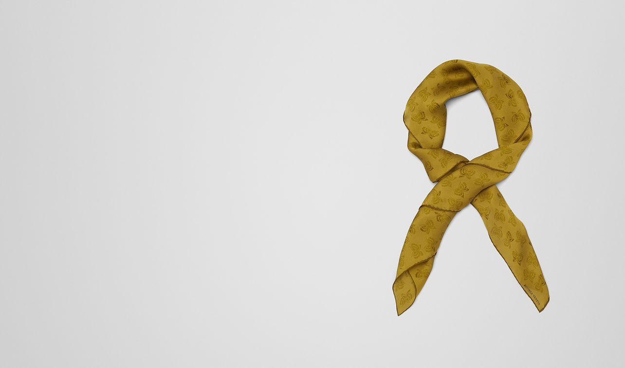 green silk scarf landing