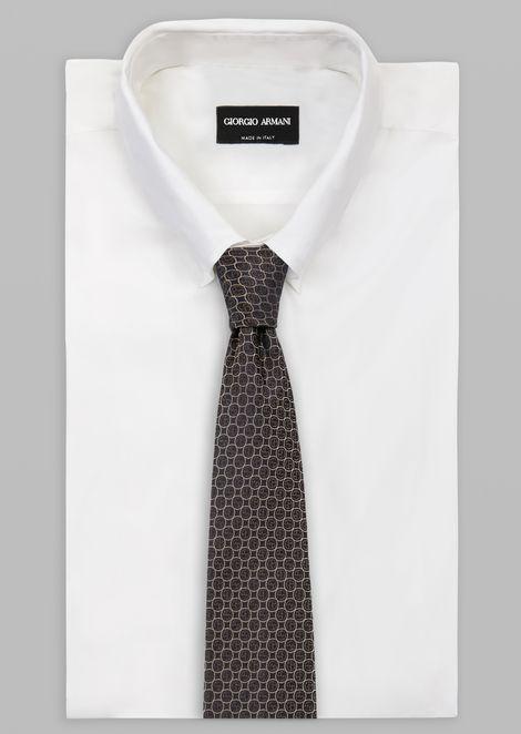 Silk tie with jacquard logo pattern